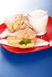 Two apple cakes and a glass of milk Stock Photography