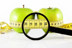 Two apple meter and magnifying glass Stock Photos