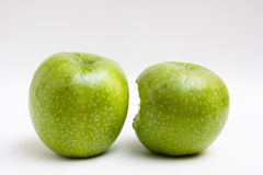 Two apple, one bite Royalty Free Stock Images