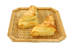 Two apple turnovers in wood basket Royalty Free Stock Images