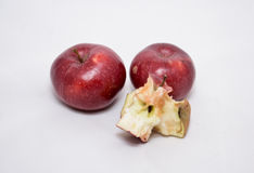 Two apple and two apple core. On the white background Royalty Free Stock Images