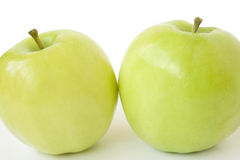 Two apples. Two big green apples are isolated on a white background Stock Photo