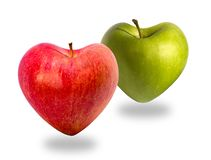 Two apples as healthy food symbol. Red and green apples in heart shapes, isolated on white background, with shaddows royalty free stock photos
