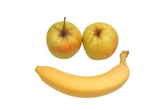 Two apples and banana. Two apples and a banana in the shape of the face Stock Image