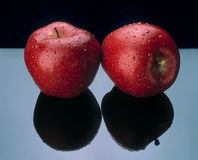 Two apples with black reflection. Royalty Free Stock Photo