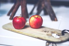 Two apples on the board Stock Photos