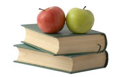 Two apples on the books. With green cover isolated over white Stock Photography