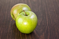 Two apples on a dark wooden table Royalty Free Stock Images