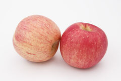 Two red fresh apples. The fresh apple on white background Stock Images