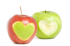 Two apples with heart. Silhouette Royalty Free Stock Photos