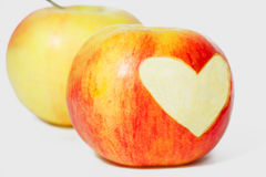 Two apples and heart shape on one apple Royalty Free Stock Photography