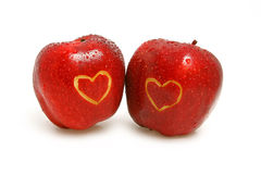 Two apples with hearts Royalty Free Stock Photos