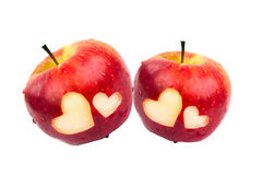 Two apples with hearts on a white background Royalty Free Stock Photo