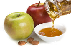 Two apples and honey Stock Photos