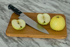 Two apples and a knife royalty free stock image