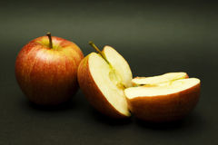 Two apples, one halved Stock Photography