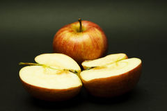 Two apples, one halved Stock Photos