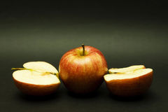 Two apples, one halved Royalty Free Stock Images