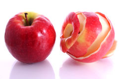 Two apples, one is peeled. Two red apples on a white background, one apple is peeled royalty free stock photos