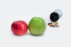 Two apples and pills Stock Image