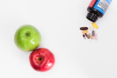 Two apples and pills Royalty Free Stock Images