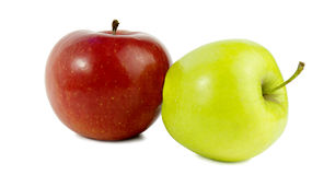 Two apples. Red Apple and green lies on the side. Stock Photos
