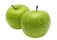 Two Apples Side by Side w/ Path. Isolated green apples with waterdrops. File contains a clipping path Stock Photos
