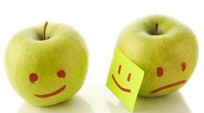 Two apples, smiling and crying on white. Concept Stock Photo