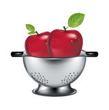Two apples in steel drainer isolated Stock Photos