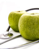 Two apples and stethoscope Royalty Free Stock Image