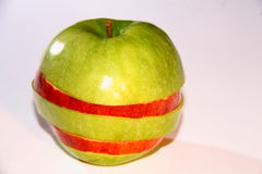 Two apples. In strips on the table Royalty Free Stock Image