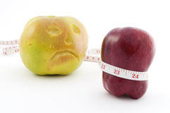 Two apples with tape measure Stock Images