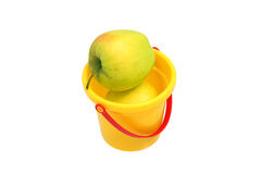 Two apples in bucket. Two apples in a yellow plastic bucket Royalty Free Stock Images
