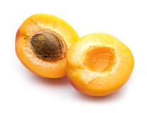 Two apricot halves with stone Royalty Free Stock Photo