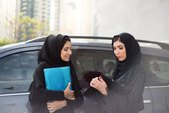 Two Arab Business Women Discuss Something Stock Photography
