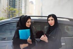 Two Arab Business Women Discuss Something Stock Photo