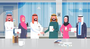 Two Arab Businessman Leaders Handshake Over Team Of Muslim Business People In Modern Office Partnership And Agreement Royalty Free Stock Photos