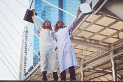 Two Arab businessmen standing by raising both hands up. In city, Business good feeling concept royalty free stock photography