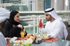 Two Arab Emirati Men Dining in a Restaurant Stock Photography