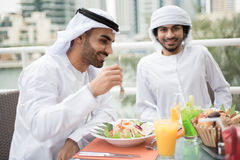 Two Arab Emirati Men Dining in a Restaurant Stock Images