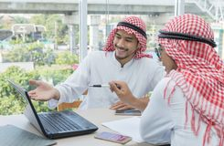 Two Arabian businessman talking agreement business contract stock photo
