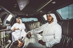 Two arabian businessmen talking about business in the company li