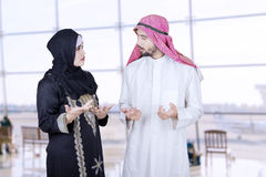 Two Arabian businesspeople talking in airport Royalty Free Stock Photos