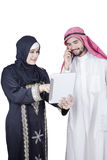 Two Arabian workers discussing with tablet Royalty Free Stock Image