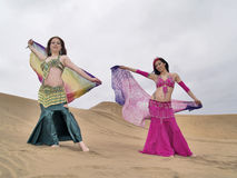 Two arabic dancers holding clothes Royalty Free Stock Image