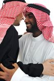 Two Arabic men having warm Stock Photo
