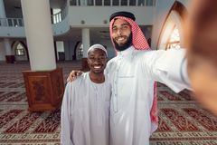 Two Arabis young men love friends selfie with smartphone. Two Arabis young men love friends selfie with smartphone stock photo