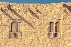 Two arc windows on an old  rouch stone wall. Royalty Free Stock Photography