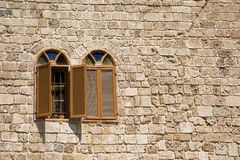 Two arch windows. On a stone wall Royalty Free Stock Photos