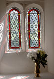 Two arched windows of a church Stock Image